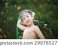 asian boy has fun playing in water 29076527
