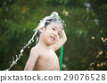 asian boy has fun playing in water 29076528