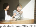 A woman who enjoys cafe sunshine talking 29078910