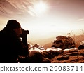 Photographer takes picture.Marvelous freeze autumn 29083714