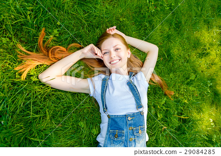 Beautiful smiling red-haired young woman 29084285