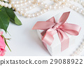 Box with pink ribbon 29088922
