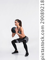 Fitness woman in sports clothing holding medicine 29089218