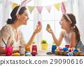 family preparing for Easter 29090616