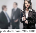 Portrait of a brunette manager in the office 29093001