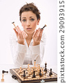 Pretty, young lady playing chess 29093915