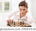 Portrait of an attractive woman playing chess 29093918