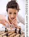 Terried young lady lokking at the chess set 29093919