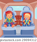Two little boys sitting in child car seats 29094312
