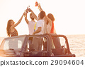 Five young people having fun in convertible car at 29094604