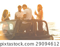 Five young people having fun in convertible car at 29094612