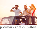 Five young people having fun in convertible car at 29094641