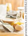 White flour and eggs. 29095623
