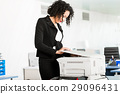 Businesswoman standing at the copying machine 29096431