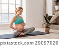 Healthy future mother doing yoga at home 29097020