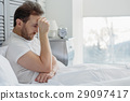 Thoughtful guy suffers from insomnia 29097417