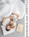 Serine man and woman napping in bedroom 29097522