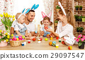 Happy easter! family mother, father and children paint  eggs for 29097547
