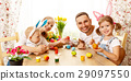 Happy easter! family mother, father and children paint  eggs for 29097550