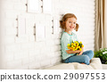 happy laughing  child girl with  yellow tulips at home 29097553