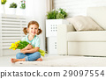 happy laughing  child girl with  yellow tulips at home 29097554