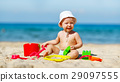 baby boy playing with toys and sand on beach 29097555