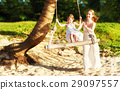 happy family at beach. mother shook child on swing in summer 29097557
