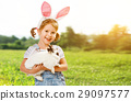 Happy easter! Pretty child girl with rabbit in nature 29097577