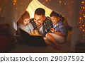 happy family father and children reading a book  in  tent at hom 29097592