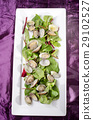 steamed clams with salad on a plate 29102527