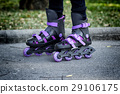 roller skates on beautiful girl's feet 29106175