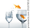 Gold fish smiling jumping from a glass of water, to a larger one, where another fish is waiting. 29107853