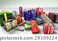 Group of gifts spread on a white surface, with one of them emphasized in the middle. 29109224