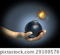 Human hand holding a bomb with burning fuse, on dark background. 29109576