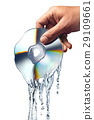 Man hand holding a compact disc whis is melting and morphing into water ripples. 29109661