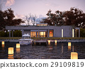 Luxury modern house on water at sunset. 29109819