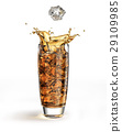 Ice cube falling into a tall glass, splashing. 29109985