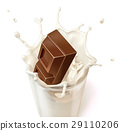 Chocolate block falling into a glass mug full of fresh milk 29110206