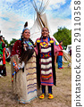Native American Indian woman in front of Tipi 29110358