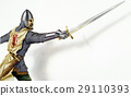Middle age Ancient warrior with a sword, in action. On white background with dropped shadow. 29110393