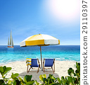 Beautiful beach with white sand, two chairs, umbrella and a sailing boat in the sea. 29110397