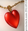Red shiny heart pendant, with gold chain, on a white paper. 29110539