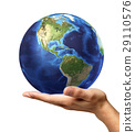 Man's hand with earth globe on it. On white background 29110576