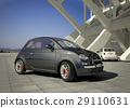 Fiat 500 city car, outside of a modern industrial building environment. 29110631
