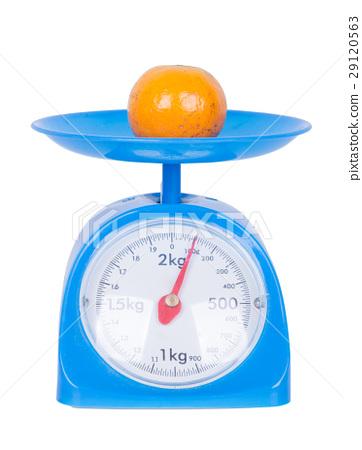 orange on kitchen scale isolated on white 29120563