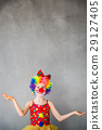 Funny kid clown playing indoor 29127405