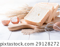 white sliced bread on wood block 29128272