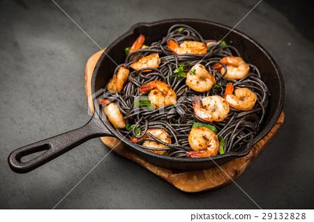 Black pasta with shrimps 29132828