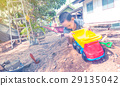 Thai baby boy palying on  pile of sand with toy 29135042