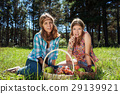 Happy young girls with a fruit basket on nature 29139921